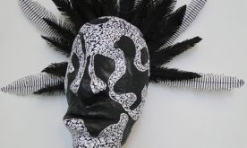 Detail paper mask, mosaic and paper feathers