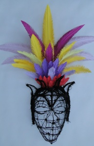 Wire mask with paper feathered head piece
